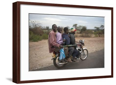 A Motorcycle Taxi Near the Town of Kasese in Uganda-Joel Sartore-Framed Art Print