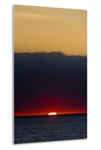 A Slither of Sunlight Pierces a Storm Cloud Above a Darkened Ocean at Sunset-Jason Edwards-Metal Print