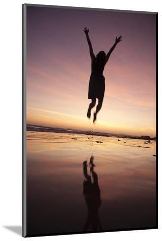 A Woman Jumping on the Beach at Sunset-Macduff Everton-Mounted Photographic Print