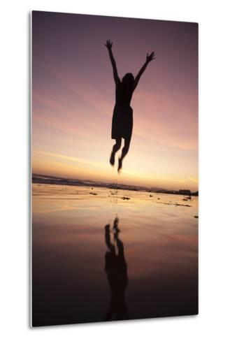 A Woman Jumping on the Beach at Sunset-Macduff Everton-Metal Print