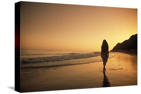 A Woman Walking on Beach at Sunset-Macduff Everton-Stretched Canvas Print