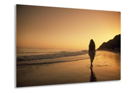 A Woman Walking on Beach at Sunset-Macduff Everton-Metal Print