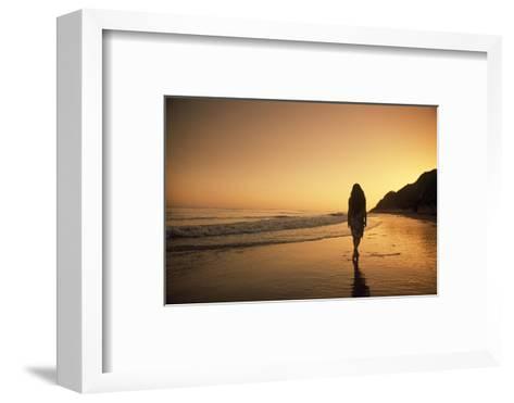 A Woman Walking on Beach at Sunset-Macduff Everton-Framed Art Print