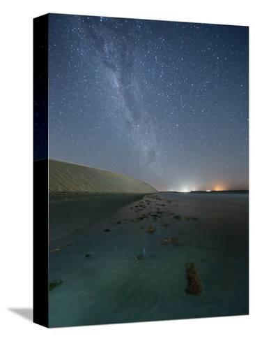 The Stars and Milky Way over the Dunes in Jericoacoara, Brazil-Alex Saberi-Stretched Canvas Print