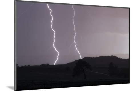 A Cloud-To-Ground Lightning Strike in a Mountainous Valley-Robbie George-Mounted Photographic Print