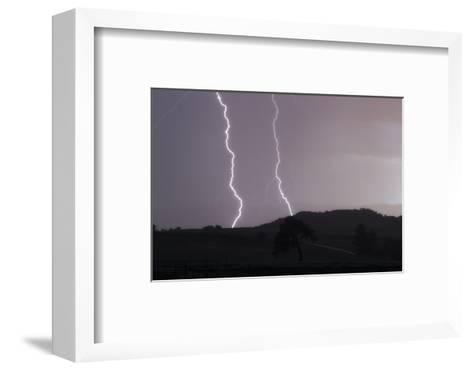 A Cloud-To-Ground Lightning Strike in a Mountainous Valley-Robbie George-Framed Art Print