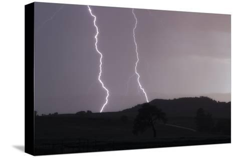 A Cloud-To-Ground Lightning Strike in a Mountainous Valley-Robbie George-Stretched Canvas Print