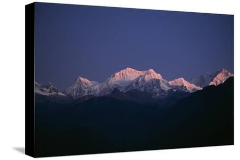 Sunrise on Kabru, Center, and Kanchenjunga, Right, the World's 3rd Highest Mountain-Macduff Everton-Stretched Canvas Print