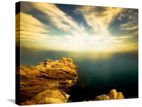 Sunlight Reflecting off Blue Waters off Cliffside-Jan Lakey-Stretched Canvas Print