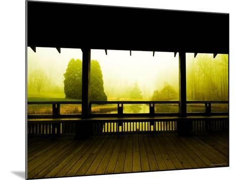 Covered Deck Looking onto Peaceful River and Fog-Jan Lakey-Mounted Photographic Print
