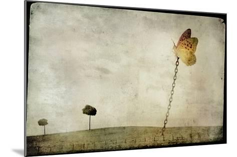 Oversized Butterfly Chained to Ground-Mia Friedrich-Mounted Photographic Print