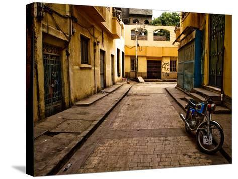 Back Street of Luxor Town, Egypt with Motorbike-Clive Nolan-Stretched Canvas Print