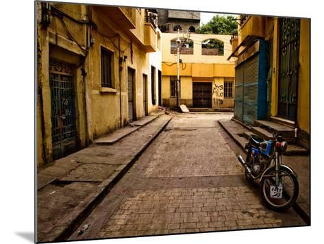 Back Street of Luxor Town, Egypt with Motorbike-Clive Nolan-Mounted Photographic Print