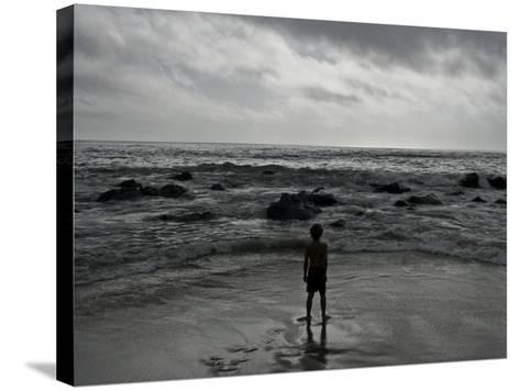 Child Standing at the Edge of Tide-Krzysztof Rost-Stretched Canvas Print