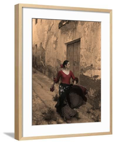 A Spanish Woman Walking Along a Traditional Spanish Street Wearing a Flamenco Style Dress-Steven Boone-Framed Art Print