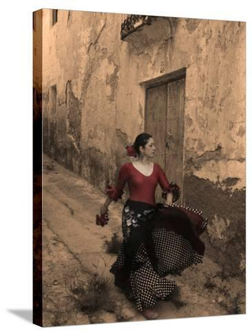 A Spanish Woman Walking Along a Traditional Spanish Street Wearing a Flamenco Style Dress-Steven Boone-Stretched Canvas Print