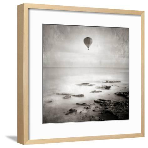 A Hot Air Balloon Floating Above the Sea-Luis Beltran-Framed Art Print