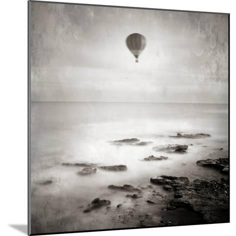 A Hot Air Balloon Floating Above the Sea-Luis Beltran-Mounted Photographic Print