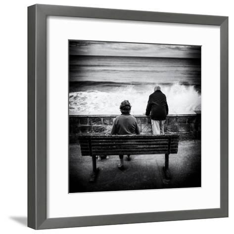 Elderly Couple Watch the Waves-Rory Garforth-Framed Art Print