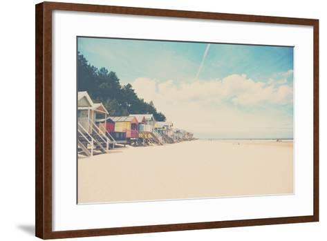 Beach Huts in England-Laura Evans-Framed Art Print
