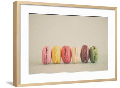 A Rainbow Selection of Sweet French Macarons Sitting in a Row.-Laura Evans-Framed Art Print
