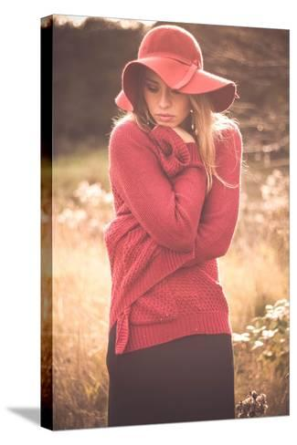 Young Woman Outdoors Wearing a Red Hat-Sabine Rosch-Stretched Canvas Print
