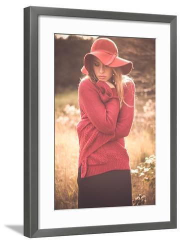 Young Woman Outdoors Wearing a Red Hat-Sabine Rosch-Framed Art Print