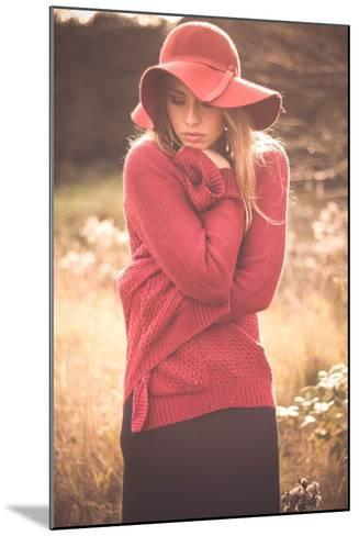 Young Woman Outdoors Wearing a Red Hat-Sabine Rosch-Mounted Photographic Print