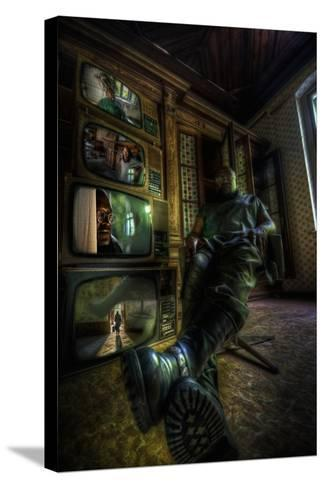 Male Figure in Abandoned Building with Televisions-Nathan Wright-Stretched Canvas Print