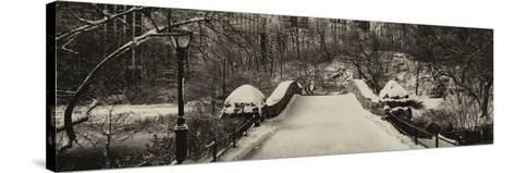 Panoramic View - Snowy Gapstow Bridge of Central Park, Manhattan in New York City-Philippe Hugonnard-Stretched Canvas Print