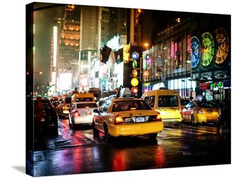 Yellow Cab on 7th Avenue at Times Square by Night-Philippe Hugonnard-Stretched Canvas Print