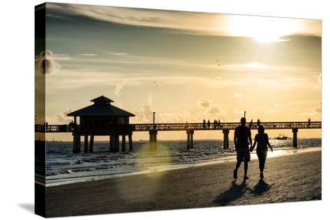 Loving Couple walking along the Beach at Sunset-Philippe Hugonnard-Stretched Canvas Print