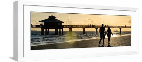 Loving Couple walking along the Beach at Sunset-Philippe Hugonnard-Framed Art Print