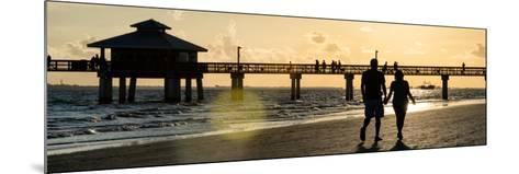Loving Couple walking along the Beach at Sunset-Philippe Hugonnard-Mounted Photographic Print