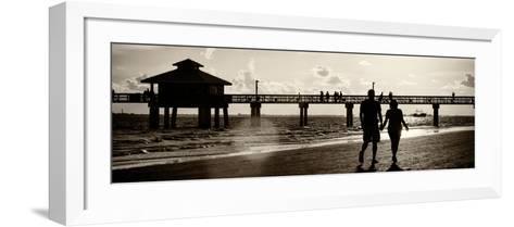 Loving Couple walking along the Beach at Sunset-Philippe Hugonnard-Framed Art Print