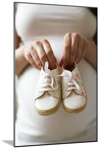 Pregnant Woman Holding Baby Shoes-Ian Boddy-Mounted Photographic Print