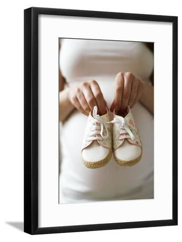 Pregnant Woman Holding Baby Shoes-Ian Boddy-Framed Art Print