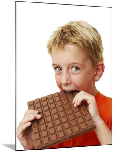 Boy Eating Chocolate-Ian Boddy-Mounted Photographic Print
