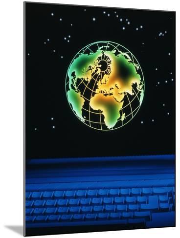 Earth Over Computer Keyboard-Tony Craddock-Mounted Photographic Print
