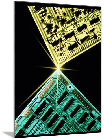 Two Circuit Boards Meeting At a Spot of Light.-Tony Craddock-Mounted Photographic Print