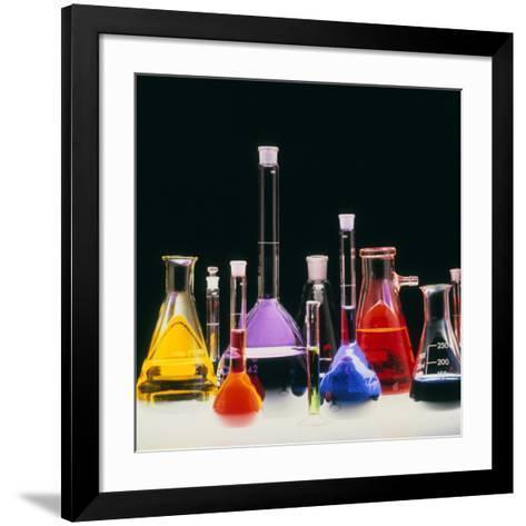 Assortment of Laboratory Flasks Holding Solutions-Tek Image-Framed Art Print