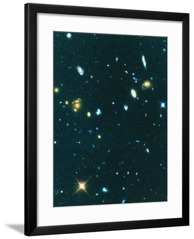 Hubble Image of Distant Irregular Blue Galaxies--Framed Art Print