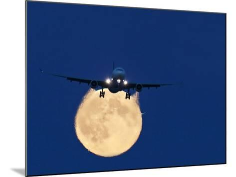 Airbus 330 Passing In Front of the Moon-David Nunuk-Mounted Photographic Print