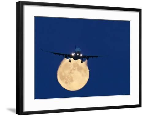 Airbus 330 Passing In Front of the Moon-David Nunuk-Framed Art Print
