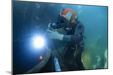 Commercial Diver Welding-Alexis Rosenfeld-Mounted Photographic Print