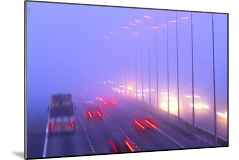Vehicles Driving Through Fog on a Motorway-Jeremy Walker-Mounted Photographic Print