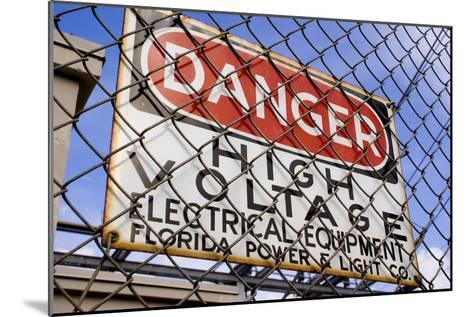 Danger High Voltage Sign In Cocoa Florida-Mark Williamson-Mounted Photographic Print