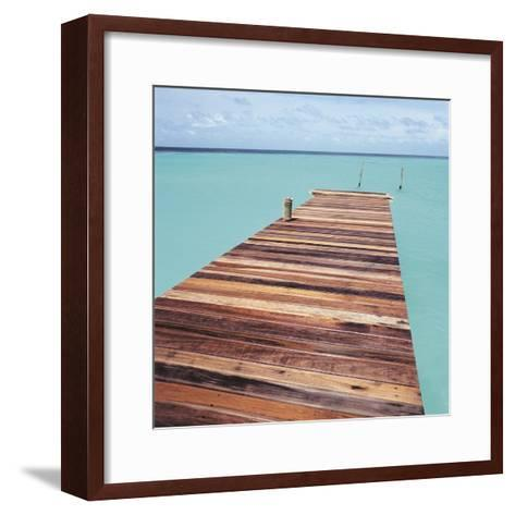 Wooden jetty leading out to sea--Framed Art Print