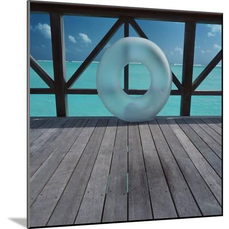 Inflatable rubber ring--Mounted Photographic Print