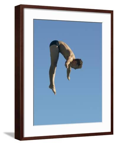 Profile shot of a young man diving--Framed Art Print